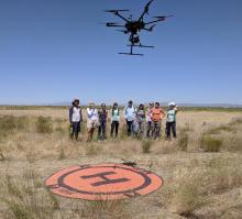 Research team from BSU, ISU and CI watch as drone launches. Photo credit, Jen Forbey.